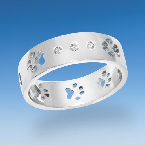 Edler Ring mit Hundepfötchen durchbrochen und 3 leuchtenden Zirkonia